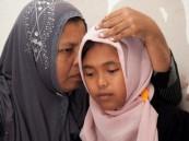 بالصور … بعد 10 أعوام من تسونامي إندونيسية تعود لأسرتها