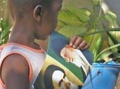 كيف علق #العريفي على صورة طفل أفريقي رفع صورة الخميني؟