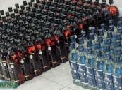 ضبط مواطنة وسائقها أثناء محاولة تهريب 1504 زجاجات خمر