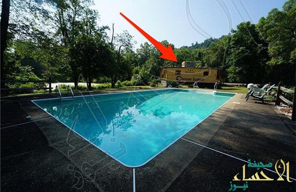 in-addition-to-an-in-ground-pool-it-has-a-train-car-right-on-the-property