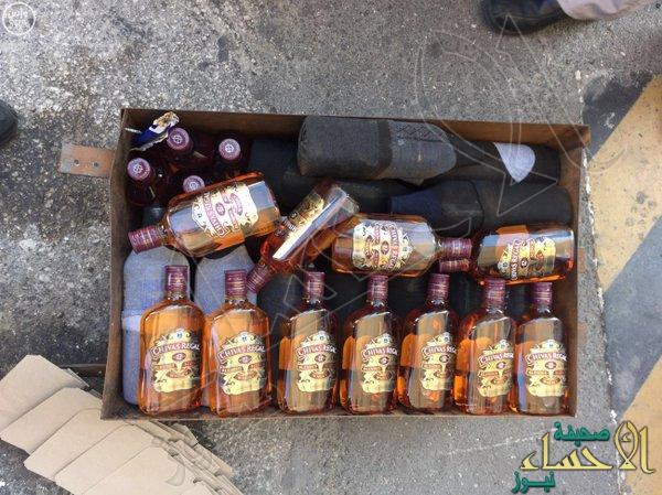 بالصور.. احباط تهريب 156 زجاجة خمر بجسر الملك فهد