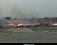 حريق هائل في منطقة قريبة من المزارع والدفاع المدني يترك بقايا الحريق إلى اجل غير مسمى